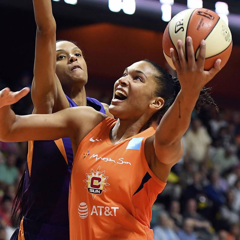 Connecticut Sun forward Alyssa Thomas shoots as Phoenix Mercury forward Dewanna Bonner defends ...