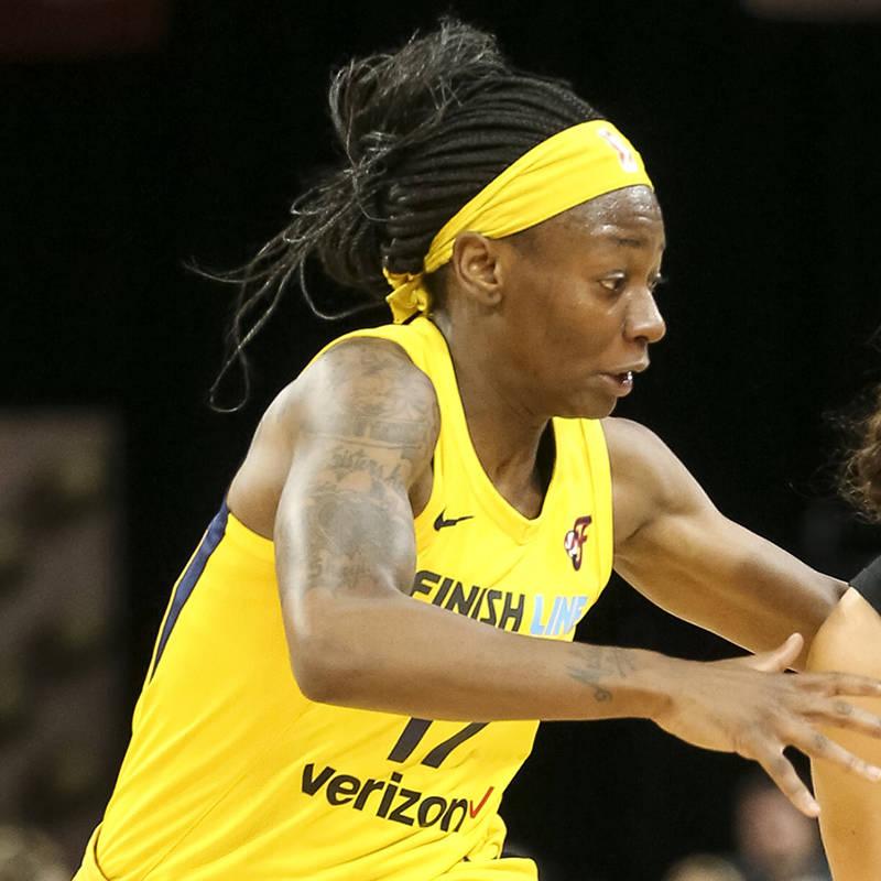 Las Vegas Aces guard Kelsey Plum (10) drives the ball past Indiana Fever guard Erica Wheeler (1 ...