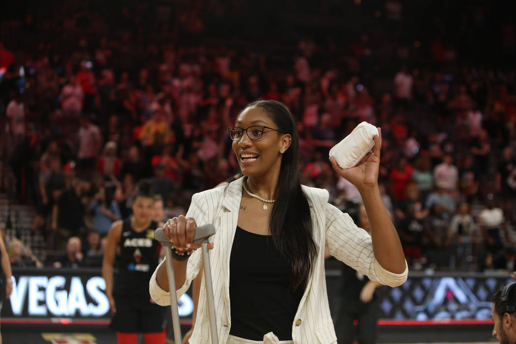 Las Vegas Aces forward A'ja Wilson throws T-shirts into the crowds of fans after the WNBA baske ...