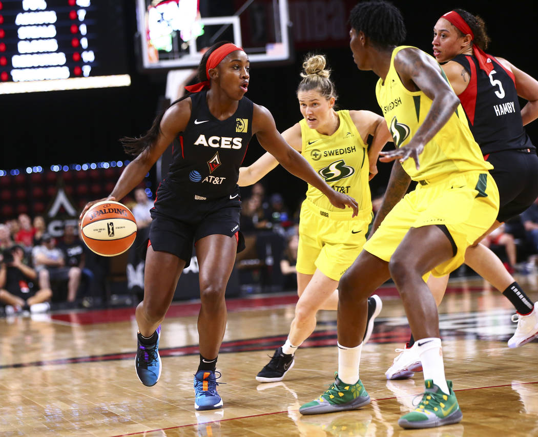 Las Vegas Aces' Jackie Young brings the ball up court against Seattle Storm during the first ha ...