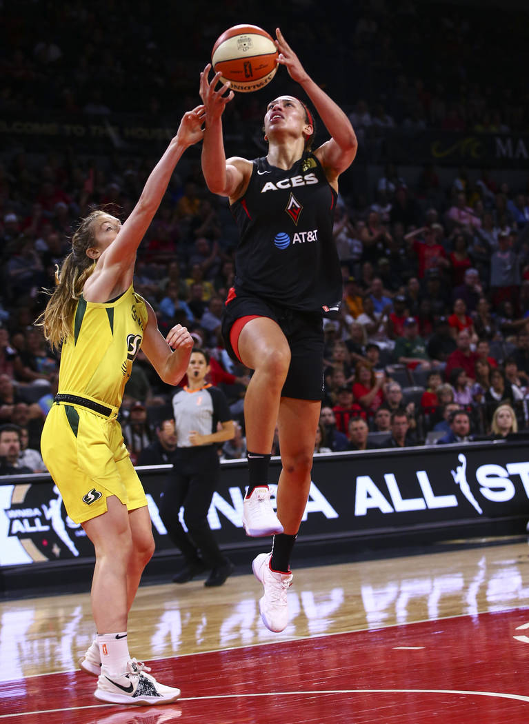 Las Vegas Aces' Dearica Hamby goes to the basket against Seattle Storm's guard Blake Dietrick d ...