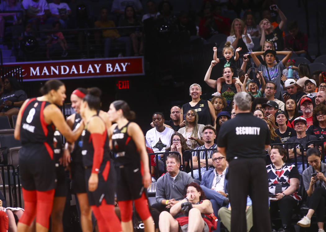 A Las Vegas Aces fans react during the second half of a WNBA basketball game against Seattle St ...