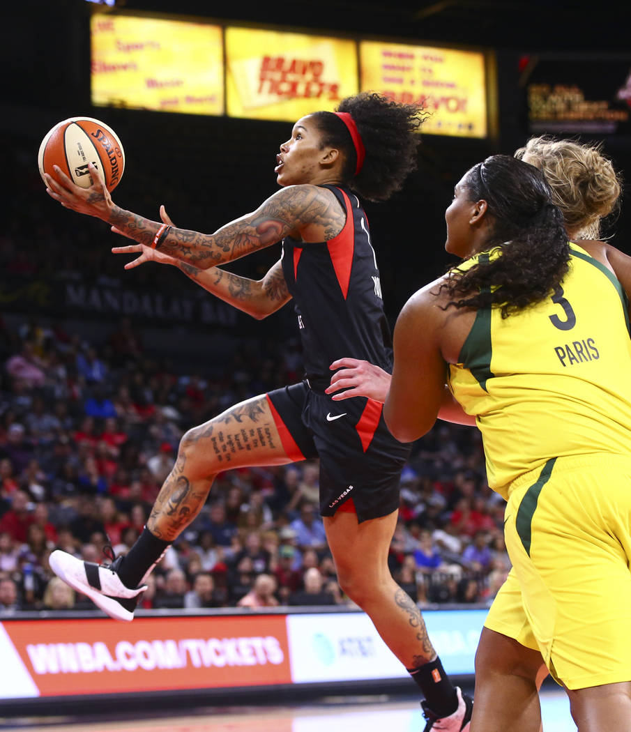 Las Vegas Aces' Tamera Young goes to the basket past Seattle Storm's Courtney Paris (3) during ...