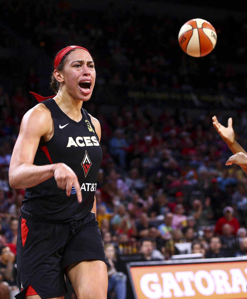 Las Vegas Aces' Dearica Hamby celebrates after scoring against Seattle Storm during the second ...