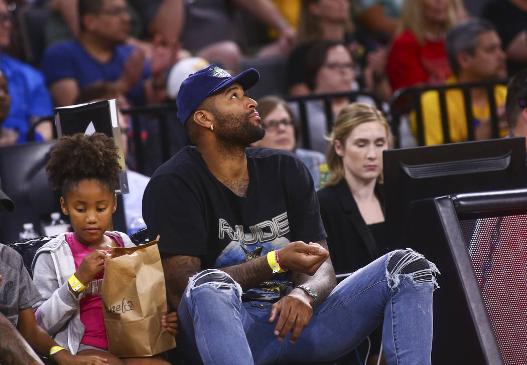 Los Angeles Lakers' DeMarcus Cousins watches the action during the second half of a WNBA basket ...