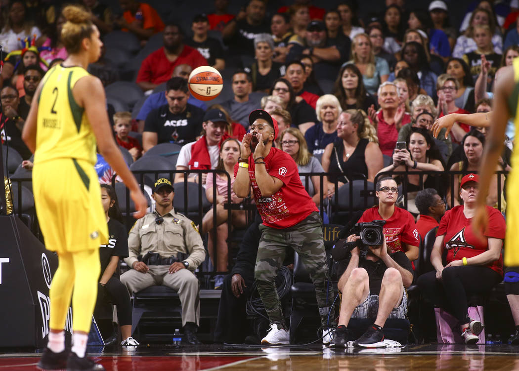 A Las Vegas Aces fan reacts during the second half of a WNBA basketball game against Seattle St ...
