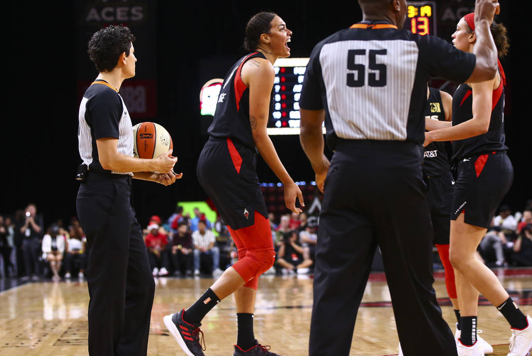 Las Vegas Aces' Liz Cambage reacts during the first half of a WNBA basketball game against the ...