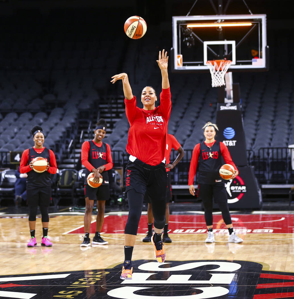Las Vegas Aces' Liz Cambage attempts a half-court shot during practice ahead of the WNBA All-St ...
