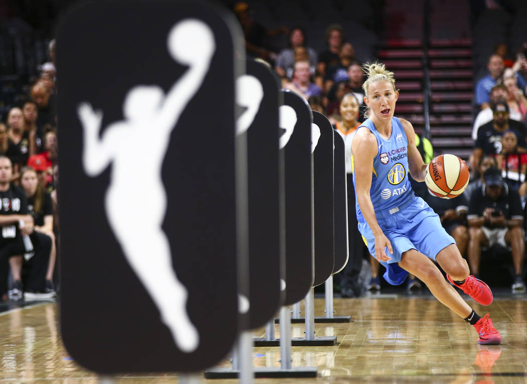 Chicago Sky's Courtney Vandersloot competes in an obstacle course involving passing and shootin ...