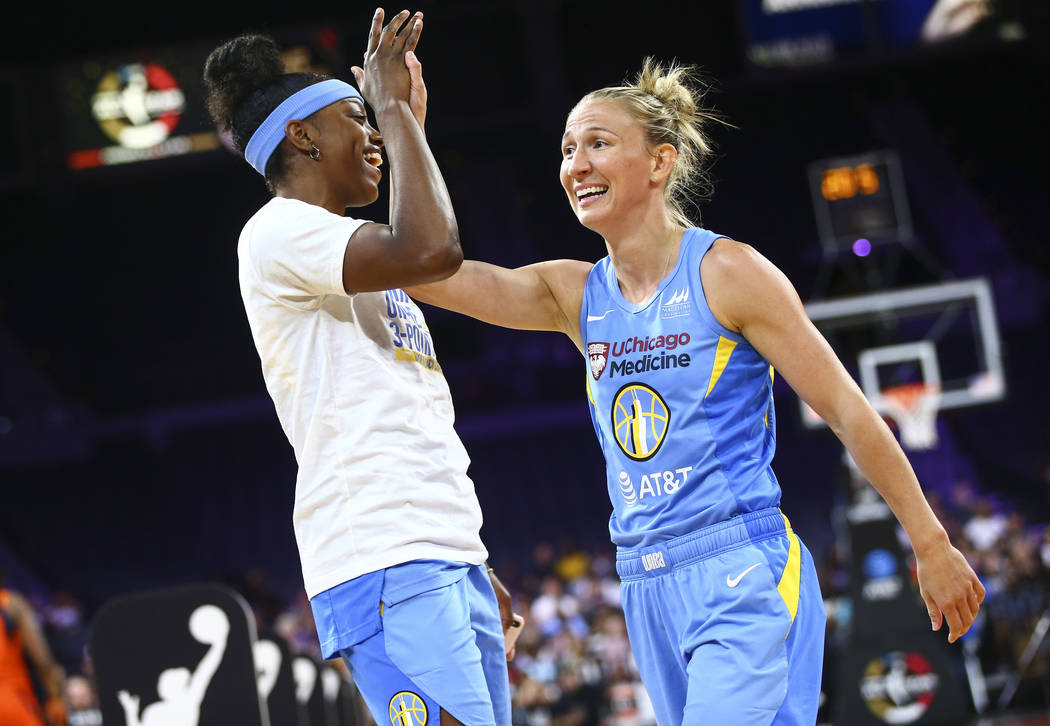Chicago Sky's Courtney Vandersloot, right, celebrates with teammates Diamond DeShields after co ...