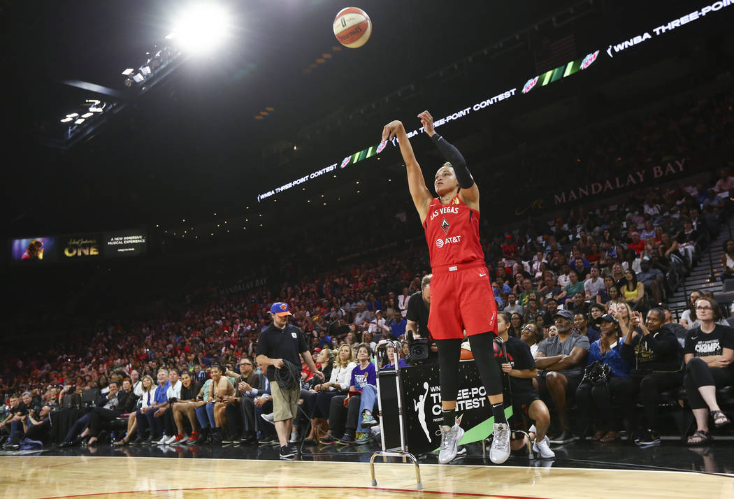 Las Vegas Aces' Kayla McBride competes in the three-point shooting challenge during the WNBA Al ...