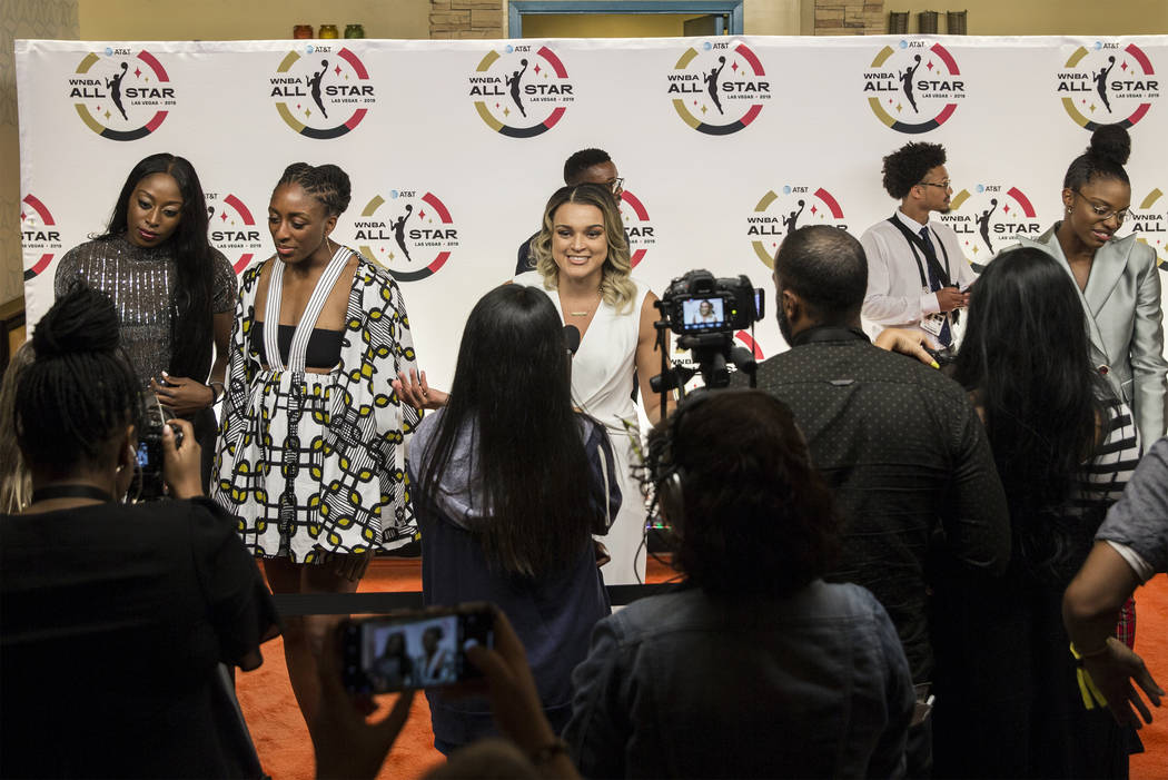 Las Vegas Aces guard Kayla McBride, center, talks to the media on the WNBA Orange Carpet outsid ...