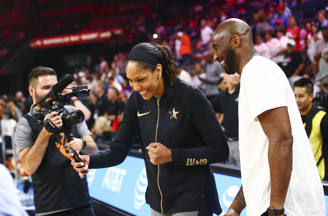 Las Vegas Aces' A'ja Wilson records a video with NBA legend Kobe Bryant before the start of the ...