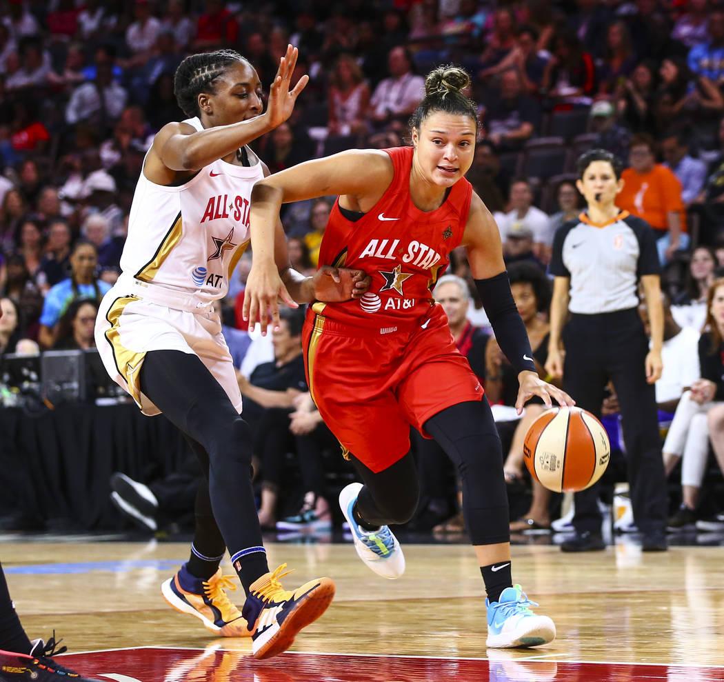 Las Vegas Aces' guard Kayla McBride drives to the basket against Los Angeles Sparks' Nneka Ogwu ...