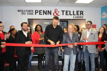 Penn Jillette, left, with Teller, of Penn & Teller cut the ribbon in the lobby of the new AFAN ...