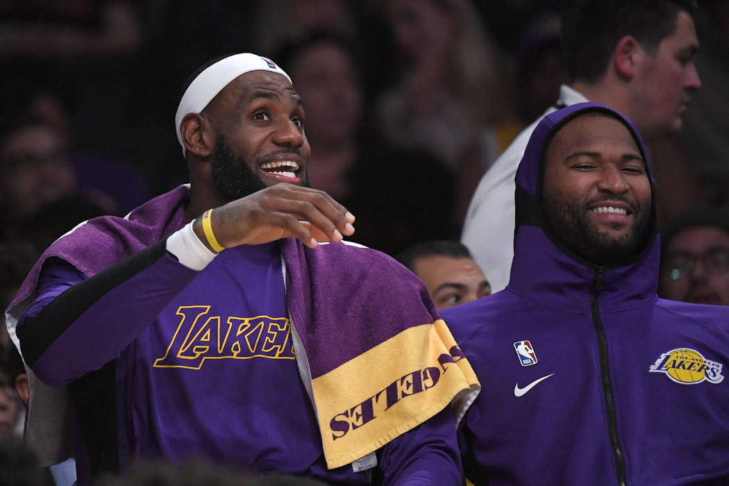 Los Angeles Lakers forward LeBron James, left, jokes around with center DeMarcus Cousins on the ...