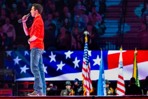 Antonio Moraes sings the National Anthem during the third day of the PBR World Finals at T-Mobi ...