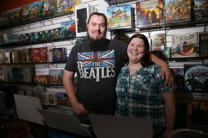 Ryan Champion, left, with his wife Allie Duda, co-owners of The Gaming Goat, pose inside their ...
