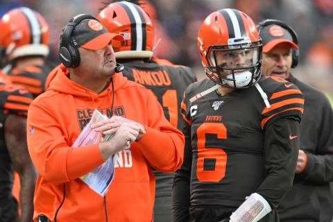 Cleveland Browns head coach Freddie Kitchens stands beside quarterback Baker Mayfield (6) durin ...