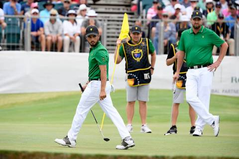International team player Abraham Ancer of Mexico, left, and playing partner Marc Leishman of A ...