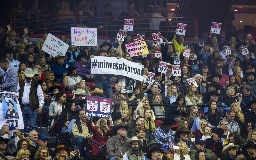 Fans cheer for their competitors during the tenth go round of the Wrangler National Finals Rode ...