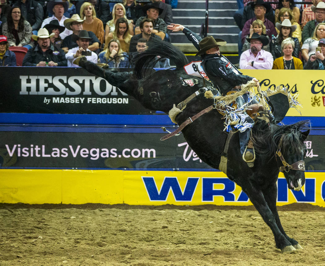 Zeke Thurston of Big Valley, Alberta, rides Kitty Whistle in Saddle Bronc Riding at the tenth g ...