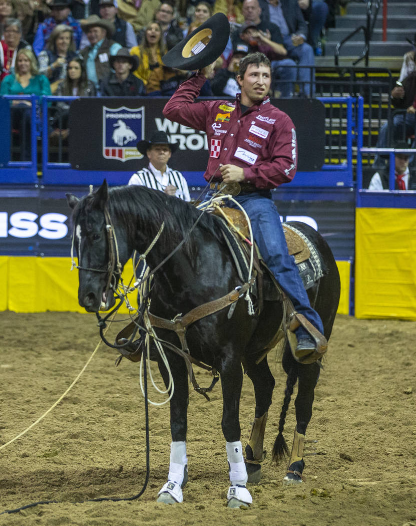 Haven Meged of Miles City, Mont., thanks the fans in Tie-Down Roping at the tenth go round of t ...