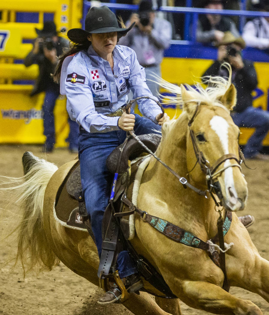 Hailey Kinsel of Cotulla, Texas, heads towards her first turn in Barrel Racing at the tenth go ...