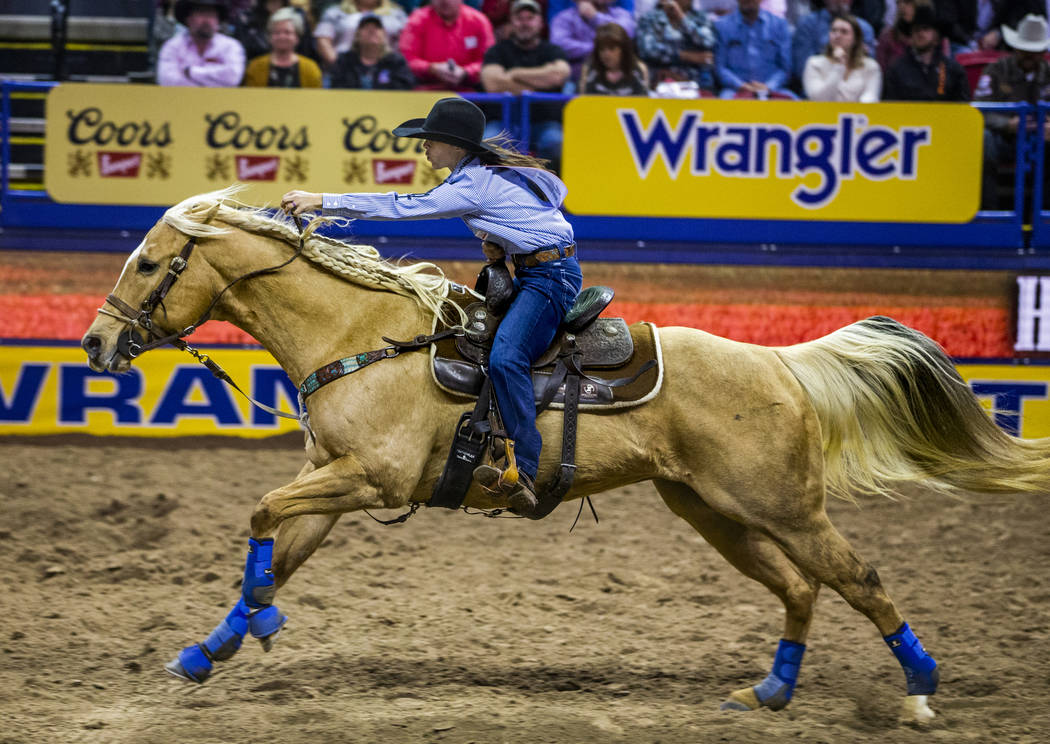 Hailey Kinsel of Cotulla, Texas, heads for home in Barrel Racing at the tenth go round of the W ...