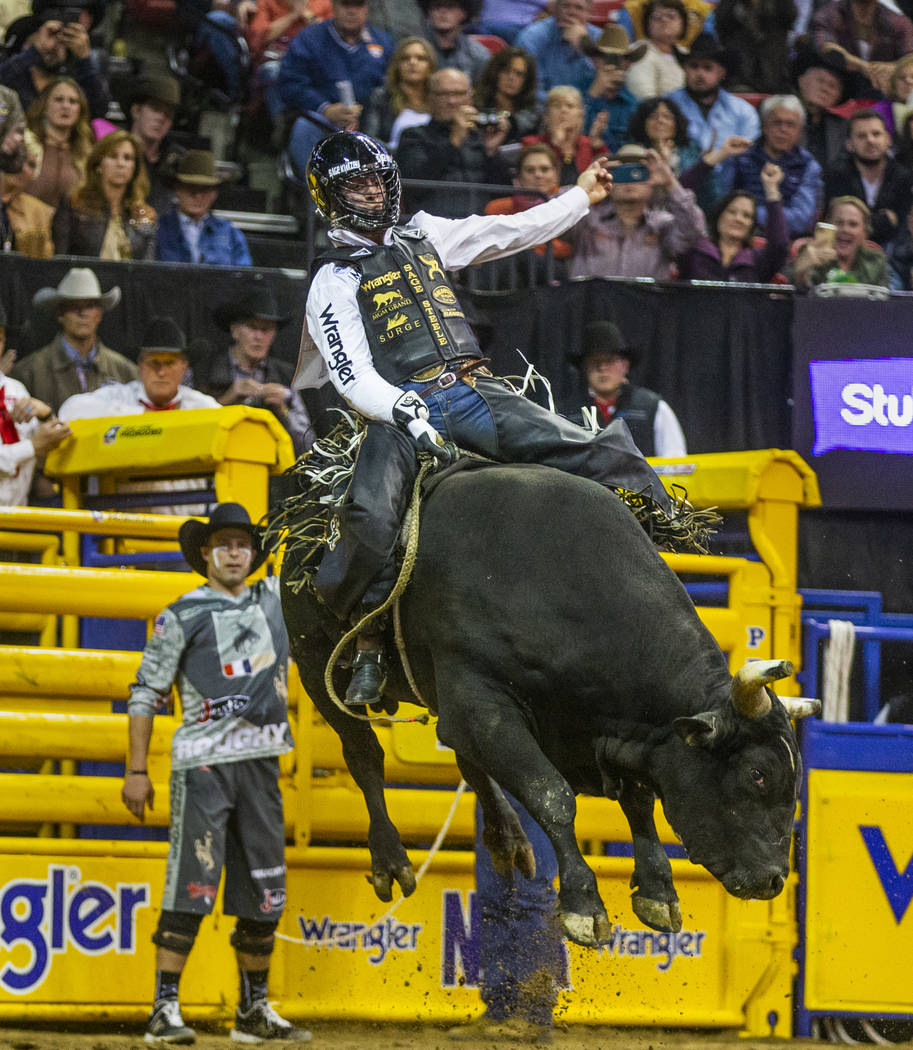 Sage Kimzey of Strong City, Okla, rides River Monster in Bull Riding during the tenth go round ...