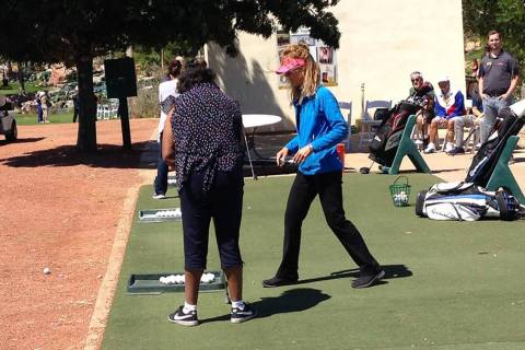 Nicole Dutt-Roberts, a PGA pro, in blue, instructs a stroke victim April 21, 2017 at Angel Park ...