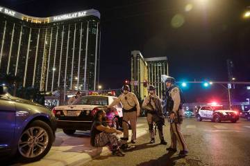 Police officers stand at the scene of a mass shooting near Mandalay Bay on the Las Vegas Strip ...