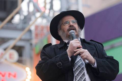 Rabbi Shea Harlig addresses the crowd at a menorah lighting hosted by the Chabada of Southern N ...