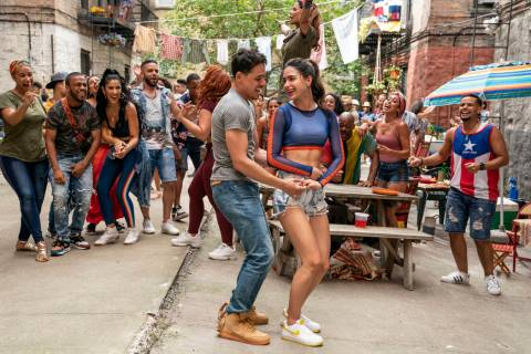 """From left, Anthony Ramos as Usnavi and Melissa Barrera as Venassa in Warner Bros. Pictures' """"In ..."""