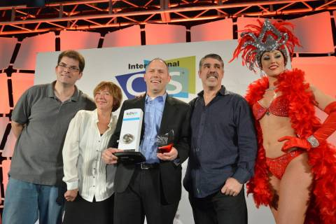 Last Gadget Standing winners, and a showgirl, display the Kevo Kwikset keyless smart lock, whic ...