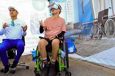 Mieron VR's Josh Dubon assists a patient using virtual reality technology during therapy. (Mier ...