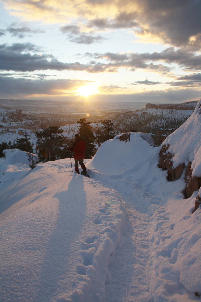 Winter hiking and snowshoeing is allowed below the rim on some of the park's trails. (De ...