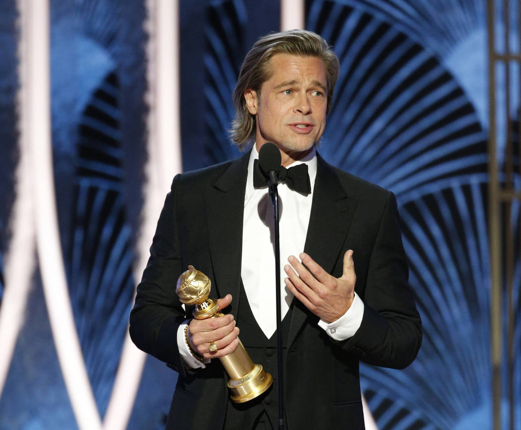 This image released by NBC shows Brad Pitt accepting the award for best supporting actor in a f ...