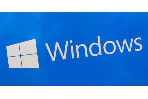FILE - This Aug. 7, 2017, file shows a Microsoft Windows sign on display at a store in Hialeah, ...