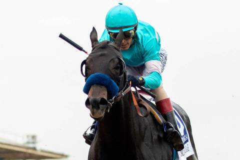 In this image provided by Benoit Photo, Eight Rings, with John Velazquez aboard, wins the Grade ...