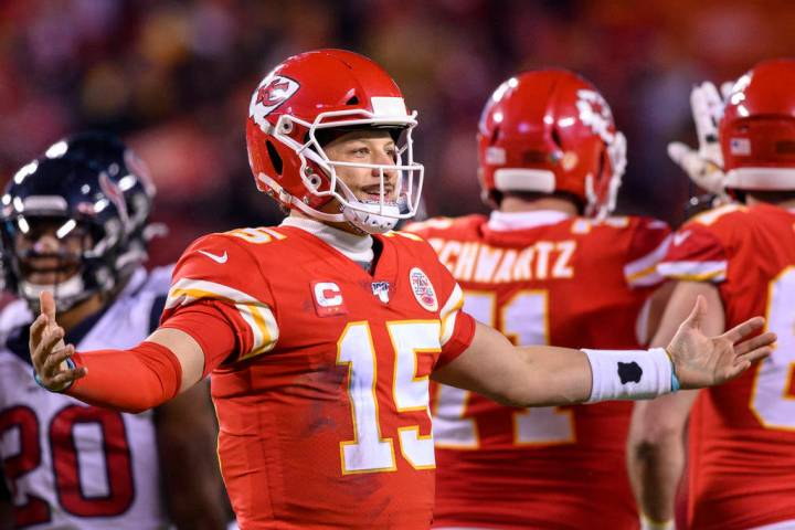 Kansas City Chiefs quarterback Patrick Mahomes (15) celebrates as time runs out in their win ov ...