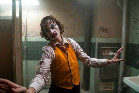 """This image released by Warner Bros. Pictures shows Joaquin Phoenix in a scene from """"Joker. ..."""