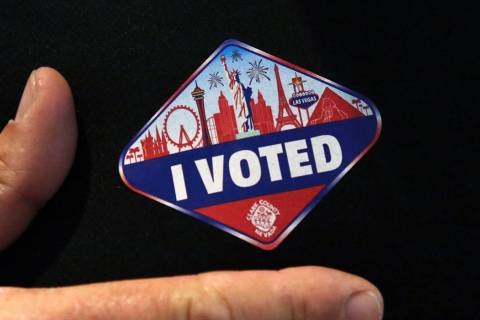 """A man shows off his """"I Voted"""" sticker after casting his ballots at a polling station at Galleri ..."""