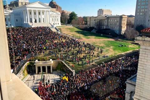 Demonstrators are seen during a pro-gun rally, Monday, Jan. 20, 2020, in Richmond, Va. Thousand ...