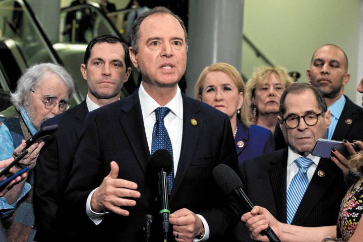 House Intelligence Committee Chairman Adam Schiff, D-Calif., accompanied by the impeachment man ...