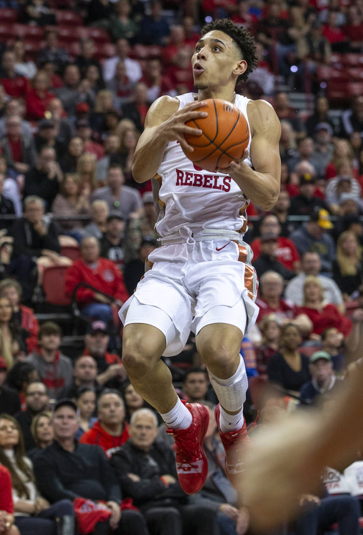 UNLV Rebels guard Marvin Coleman (31) soars to the basket past the San Diego State Aztecs defen ...
