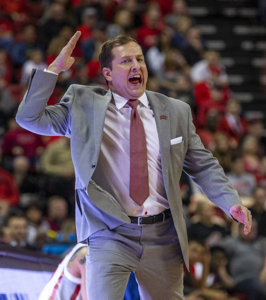 UNLV Rebels head coach T.J.Otzelberger yells in another play from the bench versus the San Dieg ...