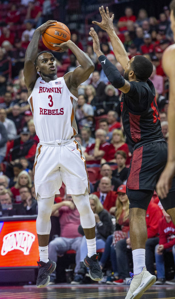 UNLV Rebels guard Amauri Hardy (3, left) elevates for a 3-point shot attempt over San Diego Sta ...