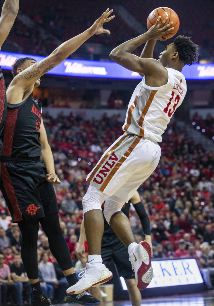 UNLV Rebels guard Bryce Hamilton (13, right) looks to take a shot over San Diego State Aztecs f ...