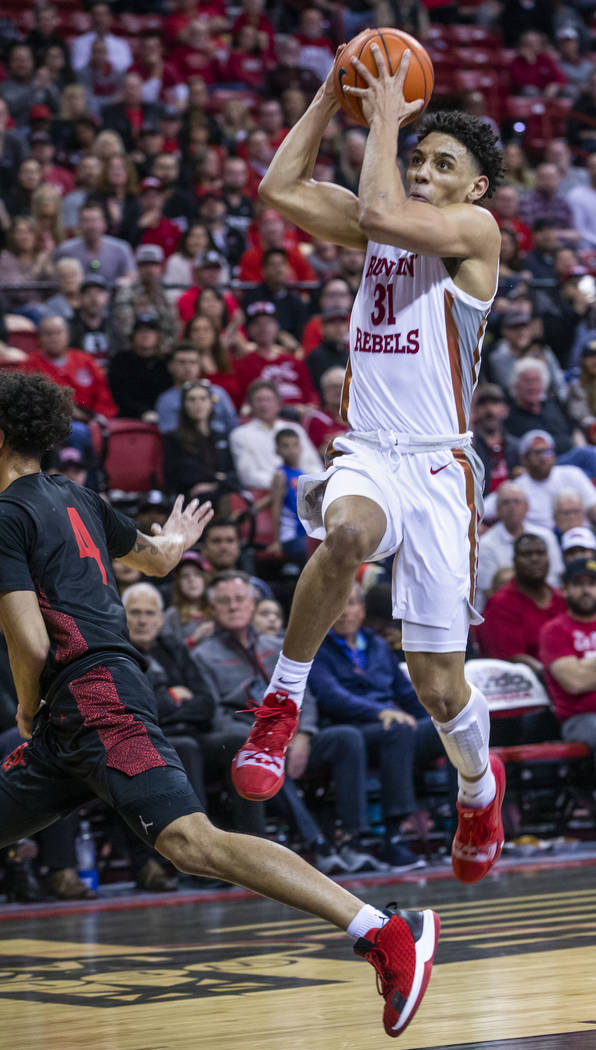 UNLV Rebels guard Marvin Coleman (31, right) looks to the basket on a drive over San Diego Stat ...